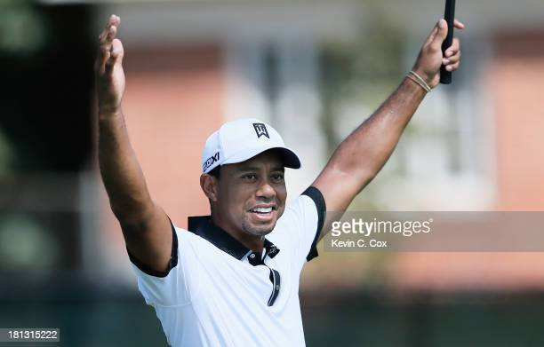 Tiger Woods reacts on the third green after making his first birdie of the tournament during the second round of the TOUR Championship by CocaCola at...