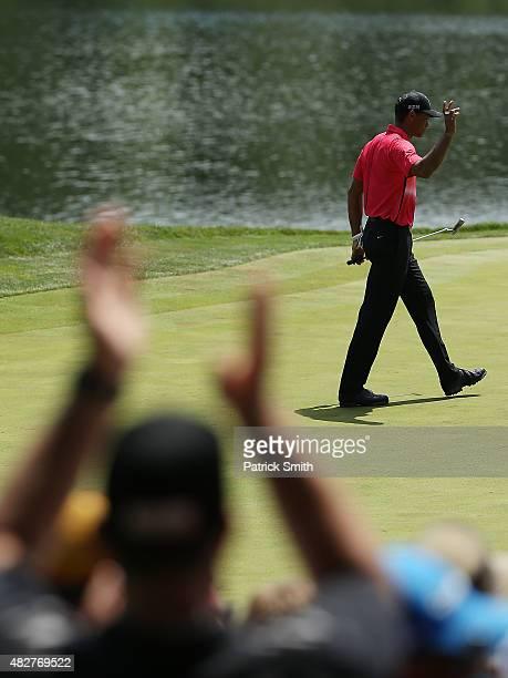 Tiger Woods reacts to a birdie on the ninth green during the final round of the Quicken Loans National at the Robert Trent Jones Golf Club on August...