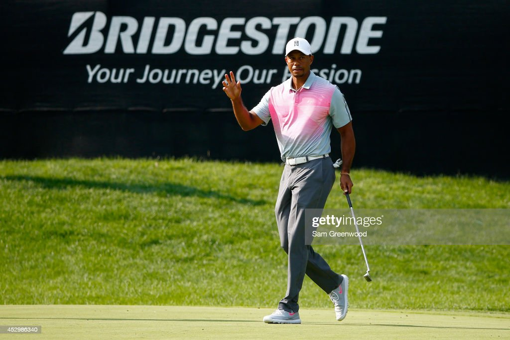 Tiger Woods reacts to a birdie putt on the 16th green during the first round of the World Golf Championships-Bridgestone Invitational at Firestone Country Club South Course on July 31, 2014 in Akron, Ohio.