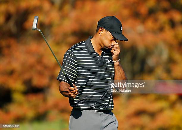 Tiger Woods reacts to a missed birdie putt on the 11th green during the first round of the Hero World Challenge at the Isleworth Golf Country Club on...