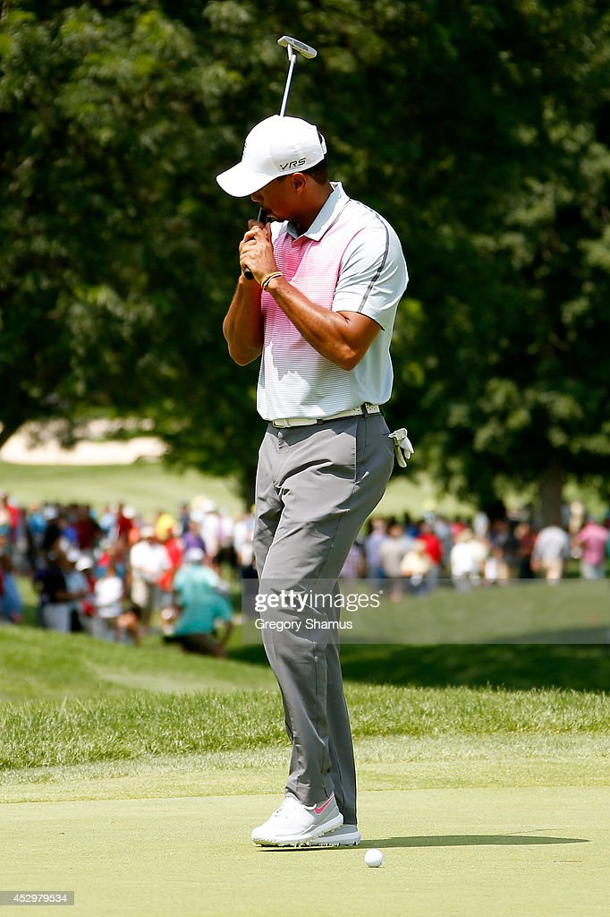 Tiger Woods reacts to a missed par putt on the first green during the first round of the World Golf Championships-Bridgestone Invitational at Firestone Country Club South Course on July 31, 2014 in Akron, Ohio.
