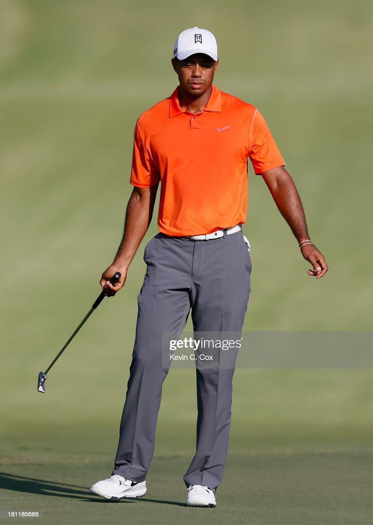 Tiger Woods reacts to a missed putt on the 16th green during the first round of the TOUR Championship by Coca-Cola at East Lake Golf Club on September 19, 2013 in Atlanta, Georgia.