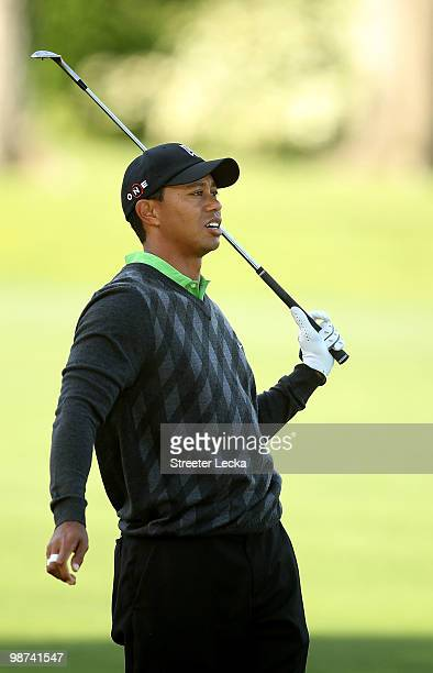Tiger Woods reacts to a poor shot on the 14th hole during the first round of the Quail Hollow Championship at Quail Hollow Country Club on April 29...