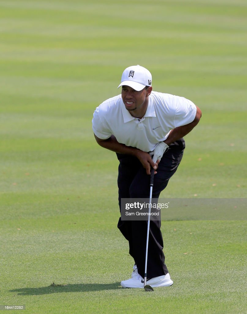 Tiger Woods reacts to a shot on the 4th hole during the third round of the Arnold Palmer Invitational presented by MasterCard at the Bay Hill Club and Lodge on March 23, 2013 in Orlando, Florida.