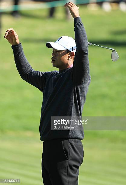 Tiger Woods reacts to a shot on the seventh hole during the first round of the Chevron World Challenge at Sherwood Country Club on December 1, 2011...