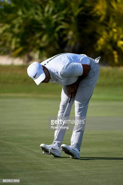 Tiger Woods reacts to barely missing a putt on the 13th green during the second round of the Hero World Challenge at Albany course on December 1 2017...
