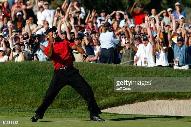 Tiger Woods reacts to his birdie putt on the 18th green to force a playoff with Rocco Mediate during the final round of the 108th US Open at the...