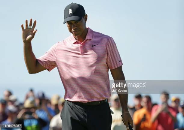 Tiger Woods reacts to his birdie putt on the second green on the South Course during the final round of the the 2019 Farmers Insurance Open at Torrey...