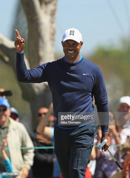 Tiger Woods reacts to his birdie putt on the seventh hole during the first round at the Arnold Palmer Invitational Presented By MasterCard at Bay...