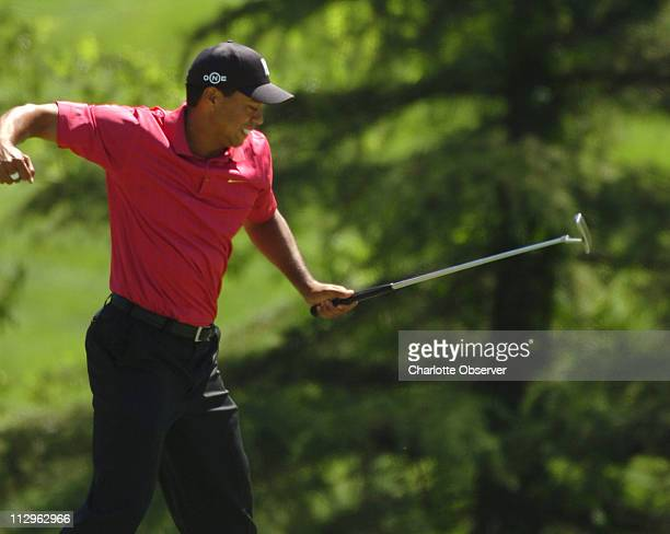 Tiger Woods reacts to his eagle shot on the seventh hole during the final round of the Wachovia Championship at Quail Hollow Club in Charlotte North...