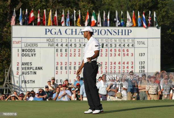 Tiger Woods reacts to his missed birdie putt on the 18th green during the second round of the 89th PGA Championship at the Southern Hills Country...