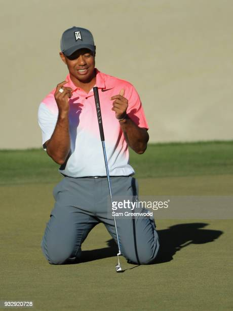 Tiger Woods reacts to his missed birdie putt on the 18th hole during the second round at the Arnold Palmer Invitational Presented By MasterCard at...
