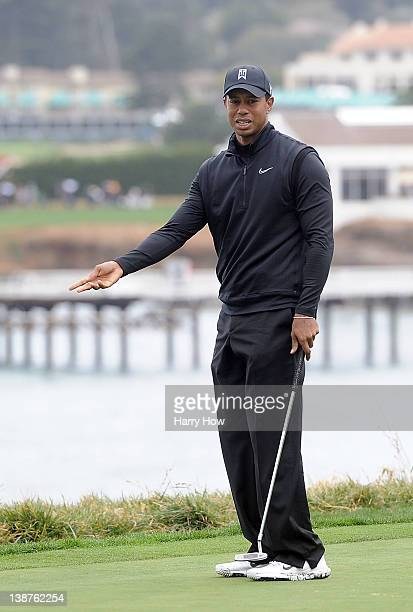 Tiger Woods reacts to his missed putt for birdie on the fifth hole during the third round of the ATT Pebble Beach National ProAm at Pebble Beach Golf...