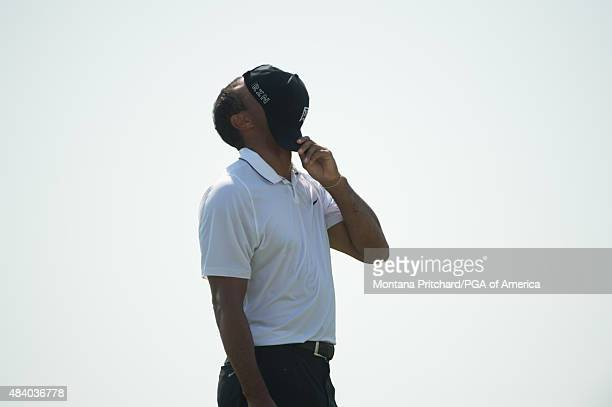Tiger Woods reacts to his previous hit on the sixteenth hole during Round Two at the 97th PGA Championship at Whistling Straits on August 14, 2015 in...