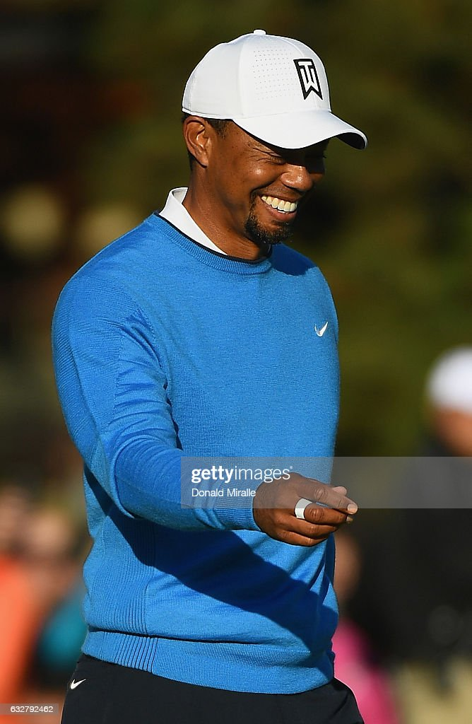 Tiger Woods reacts to his putt on the 18th hole during the first round of the Farmers Insurance Open at Torrey Pines South on January 26, 2017 in San Diego, California.