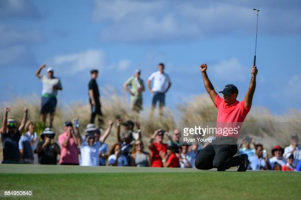 Tiger Woods reacts to his putt on the seventh green during the final round of the Hero World Challenge at Albany course on December 3 2017 in Nassau...