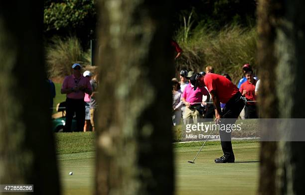 Tiger Woods reacts to his putt on the sixth green during the final round of THE PLAYERS Championship at the TPC Sawgrass Stadium course on May 10...