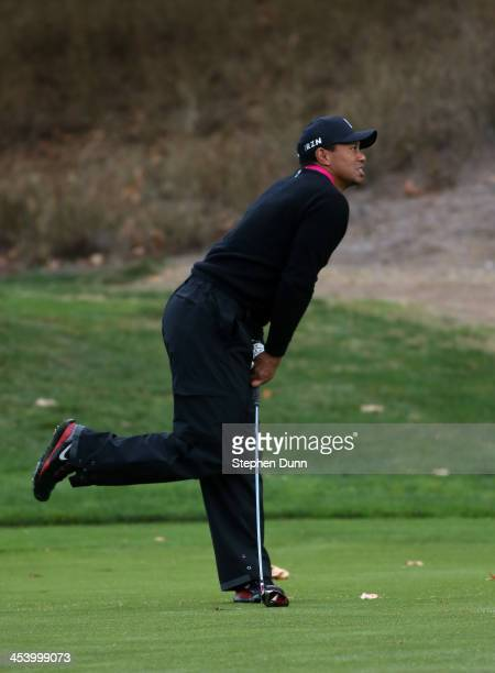 Tiger Woods reacts to his second shot on the fifth hole during the second round of the Northwestern Mutual World Challenge at Sherwood Country Club...