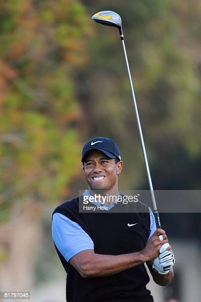 Tiger Woods reacts to his shot and winces due to pain from his knee injury during the third round of the 108th US Open at the Torrey Pines Golf...