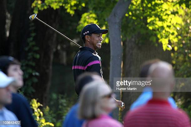Tiger Woods reacts to his tee shot on the third hole during the first round of The Barclays at the Ridgewood Country Club on August 26 2010 in...