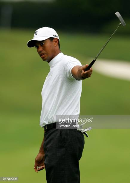 Tiger Woods reacts to making a birdie on the 3rd hole during the first round of the TOUR Championship at East Lake Golf Club on September 13 2007 in...