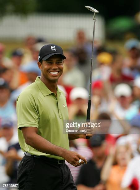 Tiger Woods reacts to making eagle at the 9th hole during the second round of the TOUR Championship the final event of the new PGA TOUR Playoffs for...