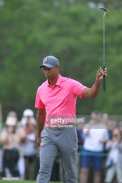 Tiger Woods reacts to sinking a birdie putt on the 10th hole during the third round of the Valspar Championship on March 10 at Westin...