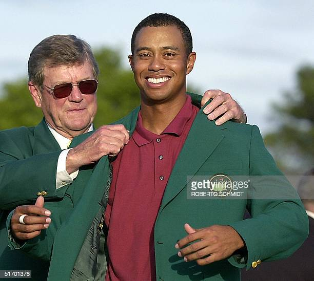 Tiger Woods receives the green jacket from tournament chairman Hootie Johnson 14 April 2002 after winning his second straight Masters Tournament at...