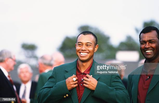 Tiger Woods Receives The Green Jacket From Vijay Singh During The 2001 Masters Tournament