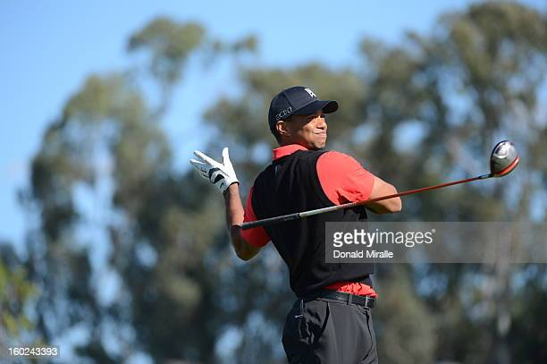 Tiger Woods releases his club after a bad hit off the 9th tee during the Final Round at the Farmers Insurance Open at Torrey Pines Golf Course on...