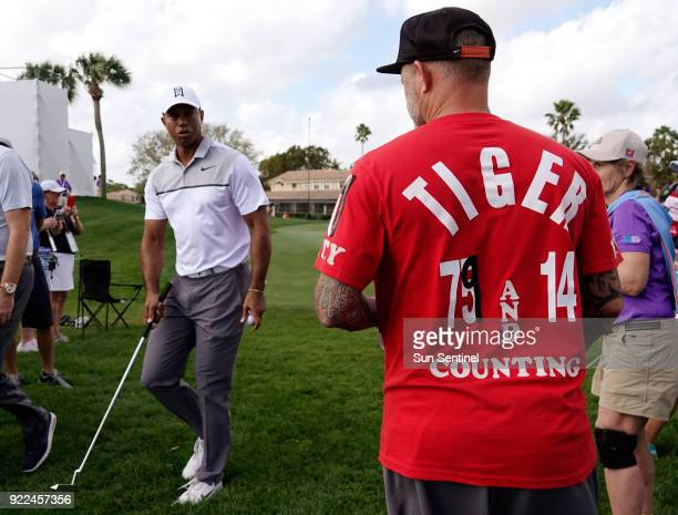 Tiger Woods says hello to his fan Chris Siska of Lake Worth on Wednesday Feb 21 2018 during the ProAm round of the Honda Classic at the PGA National...