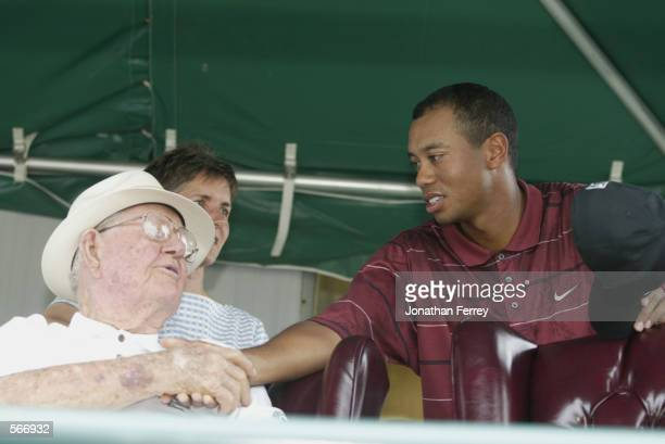 Tiger Woods shakes Byron Nelson's hand during the final round of the 2002 Verizon Byron Nelson Classic at TPC Las Colinas Golf Course in Irving Texas...