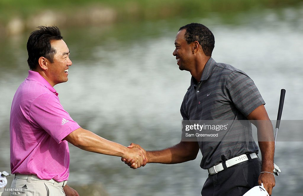 Tiger Woods (R) shakes hands with Charlie Wi of Korea following the third round of the Arnold Palmer Invitational presented by MasterCard at the Bay Hill Club and Lodge on March 24, 2012 in Orlando, Florida.