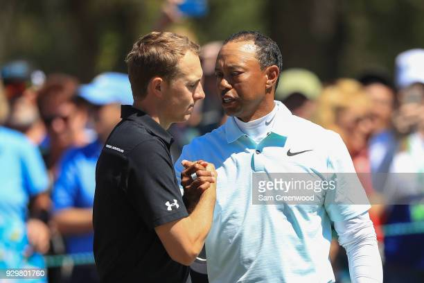 Tiger Woods shakes hands with Jordan Spieth after finishing the second round of the Valspar Championship at Innisbrook Resort Copperhead Course on...