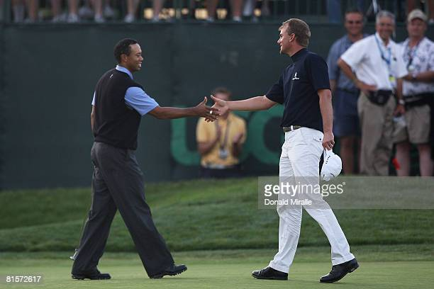 Tiger Woods shakes hands with Robert Karlsson on the 18th hole during the third round of the 108th US Open at the Torrey Pines Golf Course on June 14...