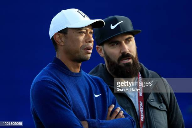 Tiger Woods shares a laugh with NFL player Eric Weddle during the Pro-Am for the 2020 Farmers Insurance Open at Torrey Pines Golf Course on January...