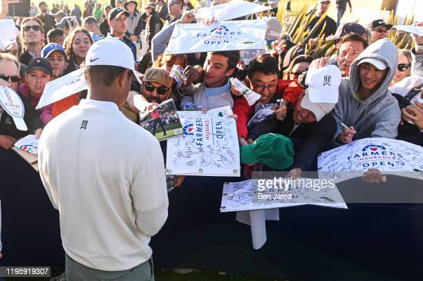 Tiger Woods signs autographs after his round during the second round of the Farmers Insurance Open at Torrey Pines South on January 24 2020 in San...