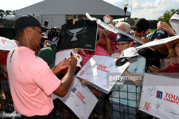 Tiger Woods signs autographs during the first round of the TOUR Championship at East Lake Golf Club on September 20 in Atlanta Georgia