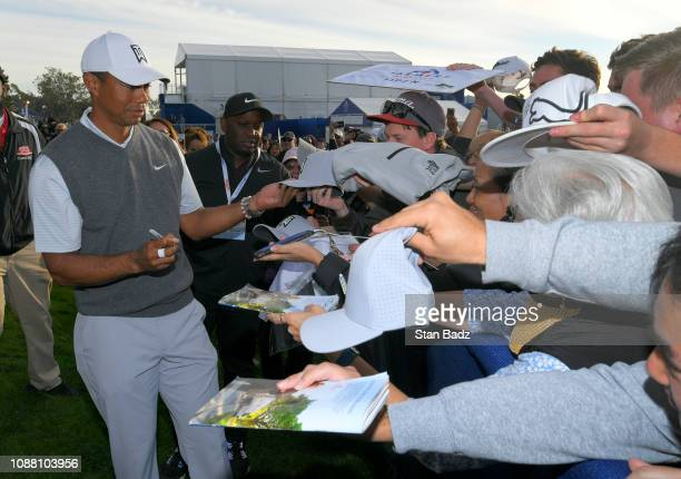 Tiger Woods signs autographs for fans after the first round of the Farmers Insurance Open at Torrey Pines South on January 24 2019 in San Diego...