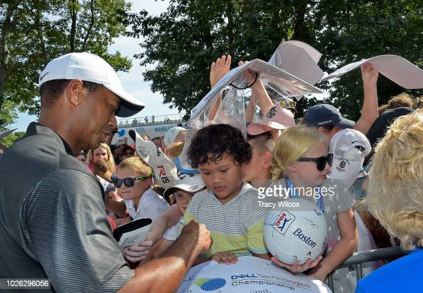 Tiger Woods signs autographs for fans after the third round of the Dell Technologies Championship at TPC Boston on September 2 2018 in Norton...
