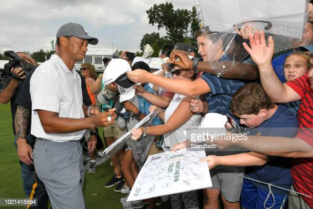 Tiger Woods signs autographs for fans prior to THE NORTHERN TRUST at Ridgewood Country Club on August 21 2018 in Paramus New Jersey