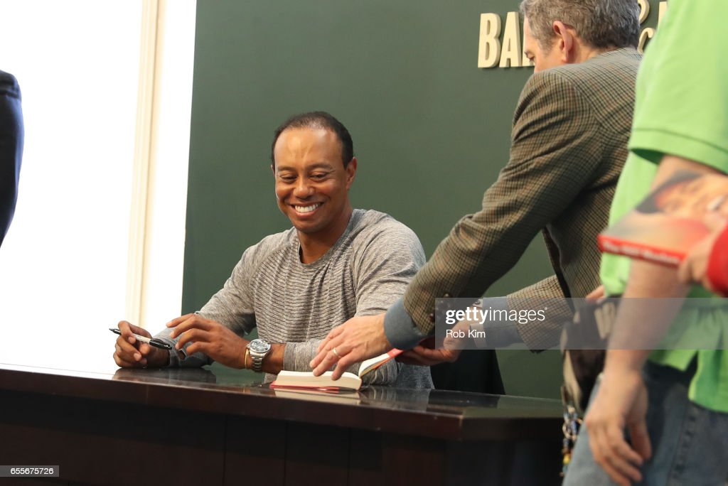 Tiger Woods signs copies of his new book, 'The 1997 Masters: My Story' at Barnes & Noble Union Square on March 20, 2017 in New York City.