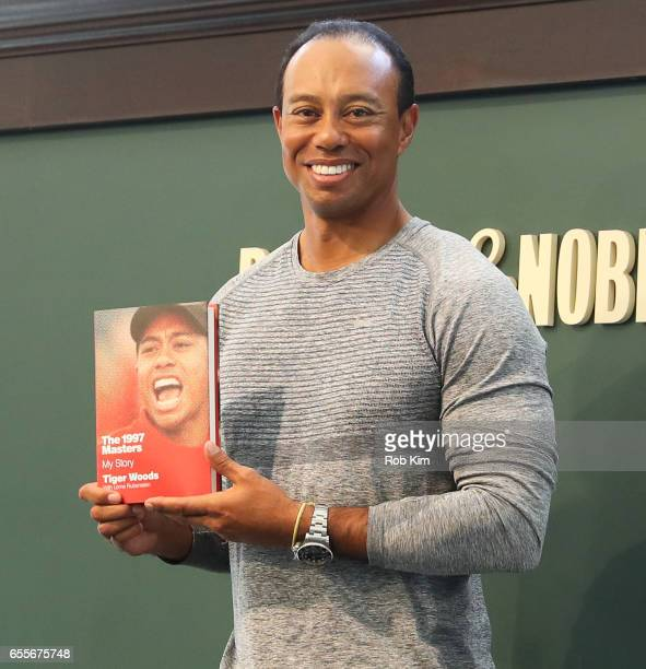 Tiger Woods signs copies of his new book 'The 1997 Masters My Story' at Barnes Noble Union Square on March 20 2017 in New York City