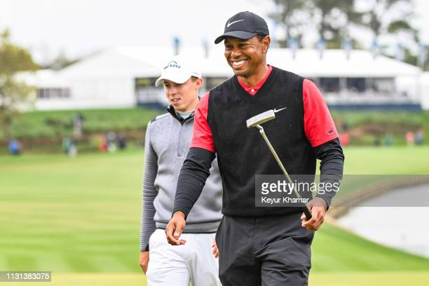 Tiger Woods smiles after finishing play on the 18th hole green with Matthew Fitzpatrick of England during the final round of THE PLAYERS Championship...