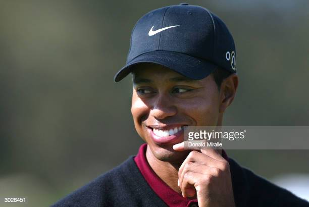 Tiger Woods smiles after his 32 victory over Davis Love III during the final round of the WGC Accenture Match Play Championship at the La Costa...