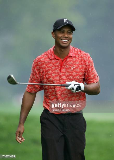 Tiger Woods smiles after hitting his approach shot on the tenth hole during the second round of the 2006 PGA Championship at Medinah Country Club on...