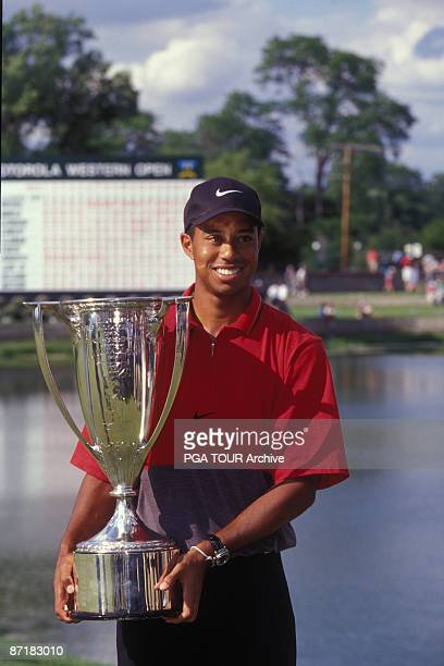 Tiger Woods smiles as he holds his trophy for the Motorola Western Open at the Cog Hill Country Club in Lemont Illinois