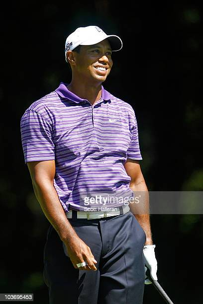 Tiger Woods smiles as he looks on from the third hole tee box during the third round of The Barclays at the Ridgewood Country Club on August 28 2010...