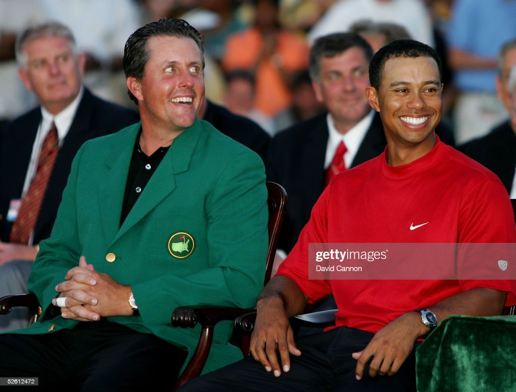 Tiger Woods smiles as he sits beside Phil Mickelson after receiving the green jacket and winning The Masters at the Augusta National Golf Club on April 10, 2005 in Augusta, Georgia.