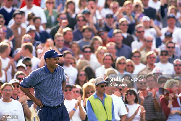 Tiger Woods smiles as he stands on the sixteenth hole during the Phoenix Open at the Tournament Players Club of Scottsdale on January 25 1997 in...
